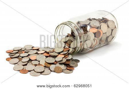 Jar Of Coins Spilled On White Background
