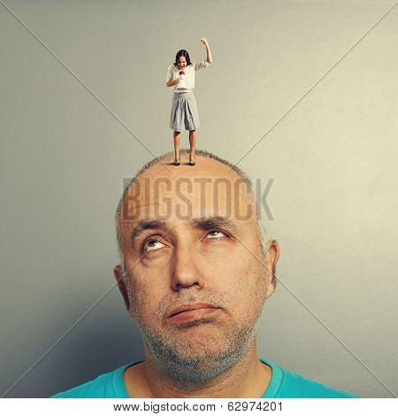 tired man and displeased woman over grey background