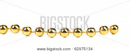 Decorative golden beads. Horisontal.