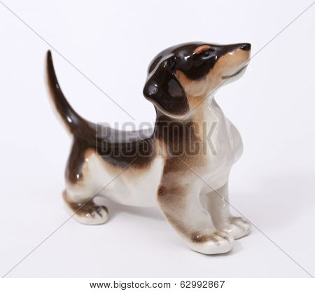 German badger Dog ceramic figurine, isolated on white