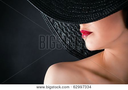 glamorous woman in hat closeup