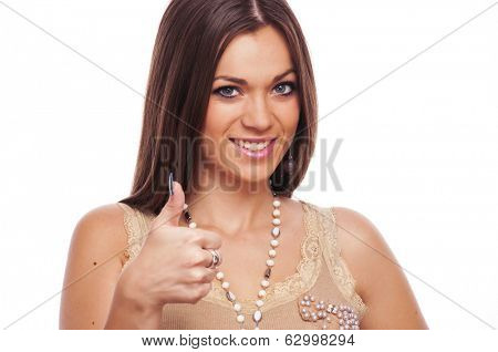Lovely brunette showing like sign with thumbs up