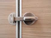 Metal Lock On Wooden Door Close Up