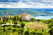stock photo of chateau  - chateau and church in Aiguines and St Croix Lake at background - JPG