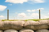 stock photo of sandbag  - trenches with barbed wire and sandbags world war one - JPG