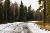 stock photo of slippery-roads  - dangerous bend in the road is slippery with poor visibility