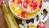 Water in bowl mixed with perfume and vivid flowers corolla Songkran festival in Thailand