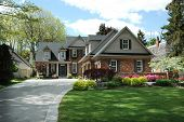 pic of manicured lawn  - Red brick house with black shutters and pretty manicured lawn  - JPG