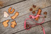 Gingerbread cookies and spices on wooden table