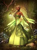 picture of fairyland  - A fairy in a beautiful dress hovers over the magical forest on gossamer wings - JPG