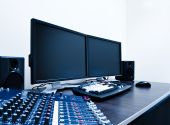 stock photo of mixer  - audio mixer and video editing workstation with modern LCDs screens - JPG
