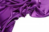 image of purple white  - Closeup of purple silk fabric on white background - JPG
