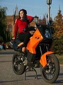 Beautiful Young Brunette Woman On A Motorcycle.