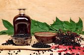 stock photo of elderberry  - The syrup of black elderberry medical healthy - JPG
