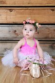 foto of bodysuit  - Baby ballerina wearing a white tutu and pink bodysuit - JPG