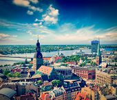 Vintage retro hipster style travel image of aerial view of Riga center from St. Peter's Church, Riga