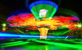 stock photo of dizziness  - Rotating carousel in the fun park - JPG
