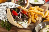 picture of gyro  - Homemade Meat Gyro with Tzatziki Sauce tomatos and French Fries