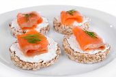 stock photo of canapes  - Delicious canapes on plate close - JPG