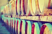 stock photo of chateau  - Wine Barrels Stacked in the Winery with filtered Effect
