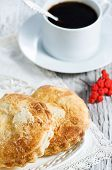stock photo of rowan berry  - Buns cup of coffee and red rowan berries - JPG
