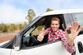 stock photo of driver  - Car driver showing car keys and thumbs up happy - JPG