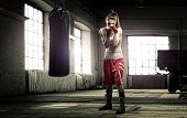 Young woman boxing workout in an old building