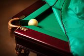 Ball In Billiard Pocket On Table