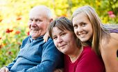 stock photo of grandfather  - Family visiting grandfather with Alzheimer - JPG