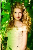 pic of loach  - Lovely girl in a lush white dress stands under a floral arch over green background - JPG