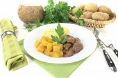 stock photo of rutabaga  - Venison goulash with turnip and potatoes on a light background  - JPG