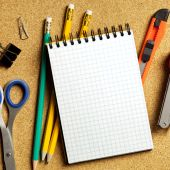stock photo of bulletin board  - Close up view of the office tools on cork board - JPG