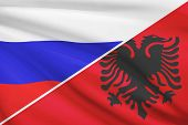 stock photo of albania  - Flag of Russia and Albania blowing in the wind - JPG