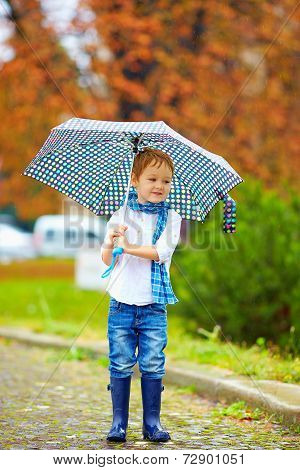 Cute Kid With Umbrella In Park, Rainy Weather