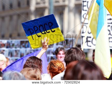 Peace Sign On The Ukrainian Flag In Protest Manifestation Against War In Ukraine