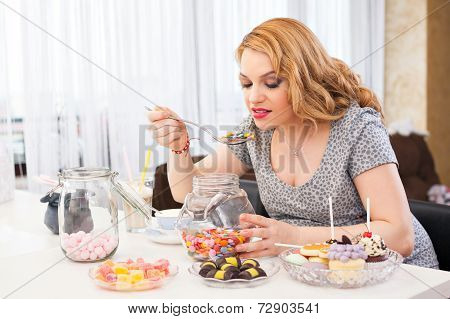 Pregnant Woman Eating Sweets