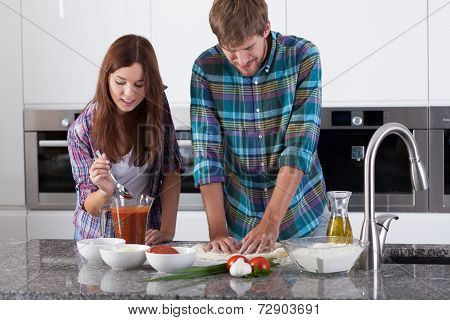 Couple Making Pizza At Home