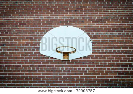 Basketball net on brick