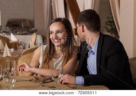 Man Whispering In Girlfriend Ear