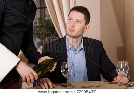Waiter Pouring A Glass Of Wine