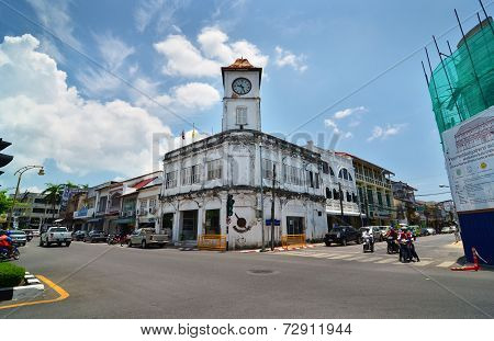 Phuket, Thailand - April 15, 2014: Local Cars Passing By The Promthep Clock Tower