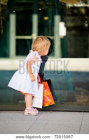 Baby at shop window