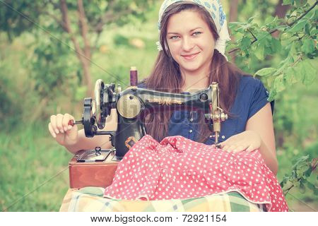Young Seamstress With Vintage Hand Sewing Machine