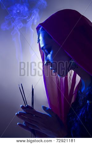 Beautiful Young Indian Woman In Traditional Clothing With Incense And Oriental Jewelry, Prayer.