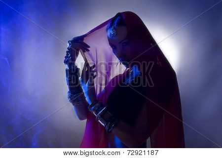 Beautiful Young Indian Woman In Traditional Clothing Silhouette With Incense And Oriental Jewelry