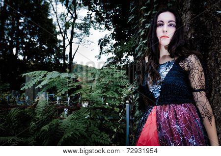 Pretty Vampire Near Tree