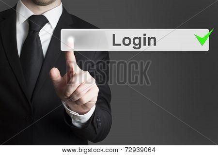 Businessman Pushing Touchscreen Button Login