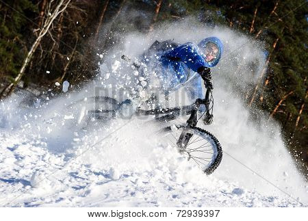 Riding bicyclist snow
