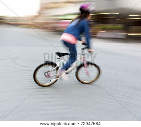 Young Girl On Small Bike