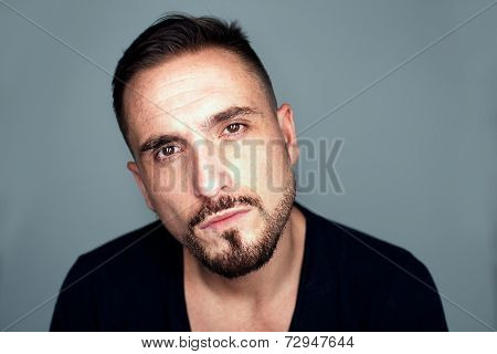 Portrait Of Serious Man With Facial Hair In Studio